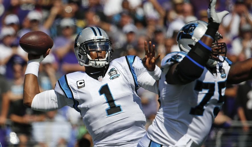Carolina Panthers quarterback Cam Newton (1) passes during the first half of an NFL football game against the Baltimore Ravens in Baltimore, Sunday, Sept. 28, 2014. (AP Photo/Evan Vucci)