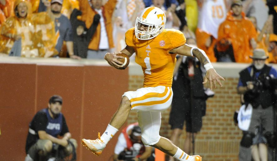 In this Aug. 31, 2014, photo, Tennessee running back Jalen Hurd scores a touchdown against Utah State during an NCAA college football game in Knoxville, Tenn. Hurd's ability to adjust to a heavy workload as a true freshman already has made an impression on coaches, teammates and even his favorite former player. Now he wants to help the Volunteers end their recent history of frustration against Florida. (AP Photo/The Knoxville News Sentinel, Michael Patrick)