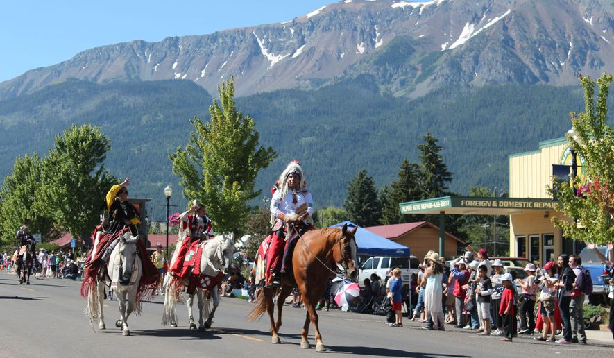 In this July 26, 2014 photo, participants take part in the annual Chief Joseph Days Parade in Joseph, Ore. The Nez Perce Trail running from Wallowa Lake to 40 miles from the Canadian border in Montana commemorates the months-long flight for freedom of Chief Joseph and his people. This fall, the U.S. Forest Service invites public comment on the siting of the 1,700-mile trail.  (AP Photo/The Observer, Katy Nesbitt)