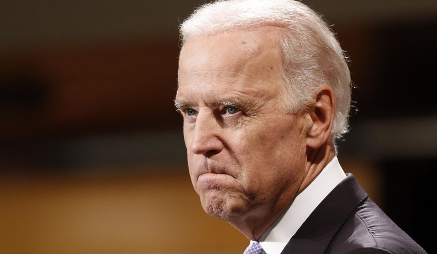Vice President Joe Biden bites his lip while speaking to students faculty and staff at Harvard University's Kennedy School of Government in Cambridge, Mass. Thursday, Oct. 2, 2014. (AP Photo/Winslow Townson)