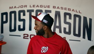 Washington Nationals center fielder Denard Span walks through the dugout during a baseball workout at Nationals Park, Thursday, Oct. 2, 2014, in Washington. The Nationals play the San Francisco Giants in the NL Division Series starting Friday. (AP Photo/Alex Brandon)