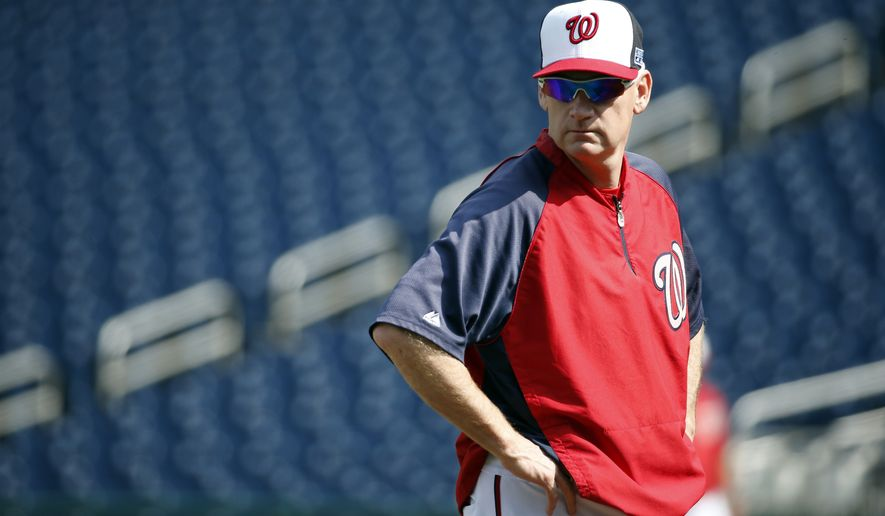 Washington Nationals manager Matt Williams stands on the mound during a baseball workout at Nationals Park, Thursday, Oct. 2, 2014, in Washington. The Nationals play the San Francisco Giants in the NL Division Series starting Friday. (AP Photo/Alex Brandon)
