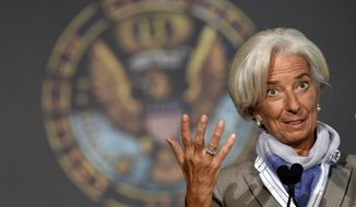"International Monetary Fund (IMF) Managing Director Christine Lagarde speaks on ""The Challenges Facing the Global Economy"" ahead of the 2014 IMF/World Bank Annual meetings, Thursday, Oct. 2, 2014, at Georgetown University in Washington. (AP Photo/Susan Walsh)"