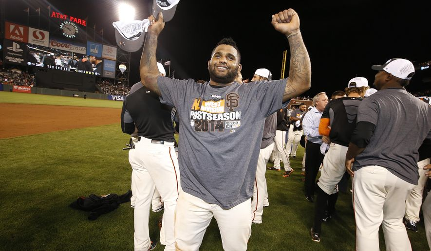 San Francisco Giants Pablo Sandoval celebrate after defeating the San Diego Padres 9-8 and clinching the wildcard in the National League West Division championship in baseball game in San Francisco, Thursday, Sept. 25, 2014. (AP Photo/Tony Avelar)
