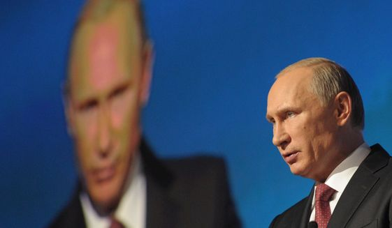 Russian President Vladimir Putin addresses an conference Russia Calling in Moscow, Russia,  Thursday, Oct. 2, 2014. (Associated Press) ** FILE **