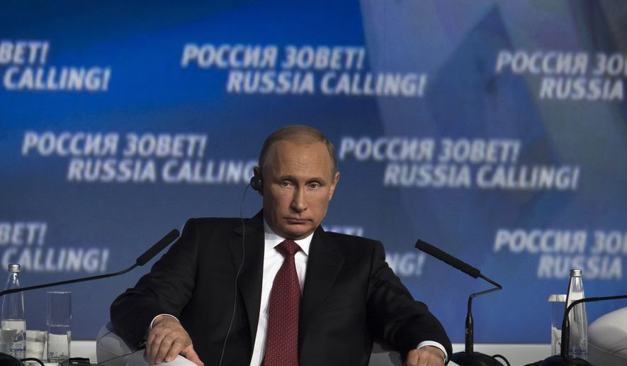 Russian President Vladimir Putin listens during an investment conference Russia Calling in Moscow on Thursday, Oct. 2, 2014.  (AP Photo/Ivan Sekretarev)