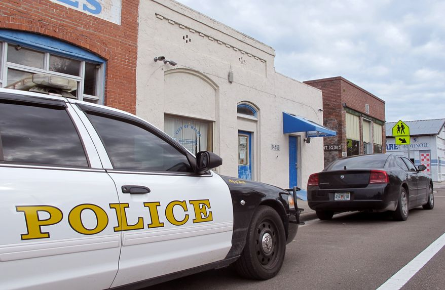 Police cars are parked in front of the Waldo Police Department in Waldo, Fla., Thursday Oct. 2, 2014. The tiny north Florida town known nationally as a speed trap decided on Tuesday, Sept. 30, 2014,  to officially dismantle its police force. The move came weeks after the police chief and interim chief resigned due to state investigations into ticket quotas, mishandling of evidence and other issues. The Alachua County Sheriff's Office is now in charge of policing the town of 1,000, leaving some citizens worried that the speeding problem will worsen, and that criminals will feel like they have carte blanche. (AP Photo/Jason Dearen)