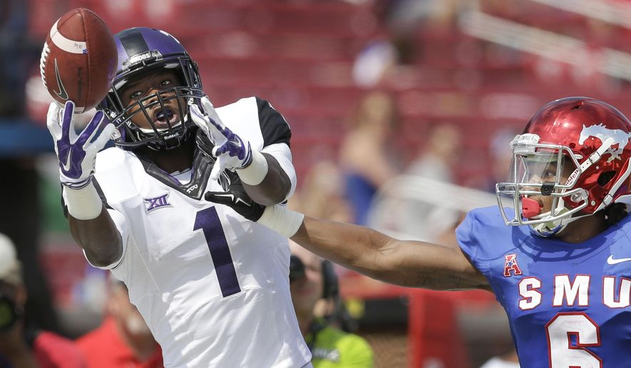 TCU wide receiver Emanuel Porter (1) reaches for a pass against SMU defensive back Jesse Montgomery (6) during the second half of an NCAA college football game Saturday, Sept. 27, 2014, in Dallas. TCU won 56-0. (AP Photo/LM Otero)
