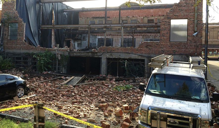 The wall of a North Main Street building collapsed next to Lonesome Dove Western Bistro following a storm at the Stockyards in Fort Worth, TX , Thursday, Oct. 2, 2014.  ((AP Photo/Star-Telegram, Ron T. Ennis)