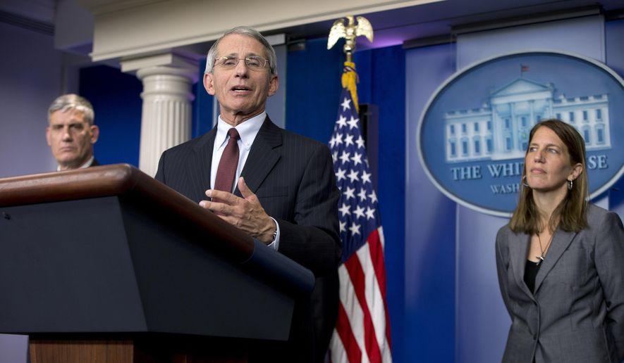 Director of the National Institute of Allergy and Infectious Diseases at the National Institutes of Health Dr. Anthony S. Fauci, joined by Secretary of Health and Human Services Sylvia Burwell, right, and Commander of the United States Africa Command Gen. David M. Rodriguez, left, speaks in the James S. Brady Press Briefing Room in White House in Washington, Friday, Oct. 3, 2014, about the U.S. Government's response to the Ebola epidemic in West Africa. (AP Photo/Carolyn Kaster)