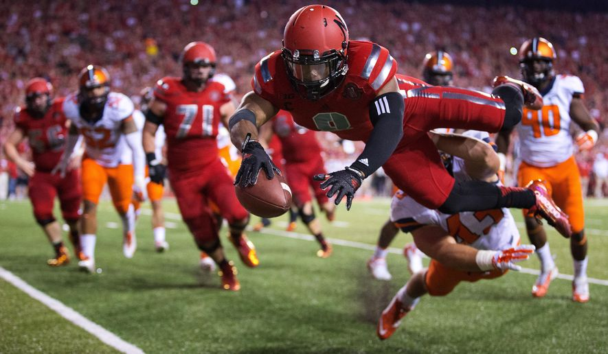 Nebraska running back Ameer Abdullah (8) dives in for a touchdown in the first  half of an NCAA college football game in Lincoln, Neb., Saturday, Sept. 27, 2014. Nebraska won 45-14. (AP Photo/The Omaha World-Herald/Matt Miller)