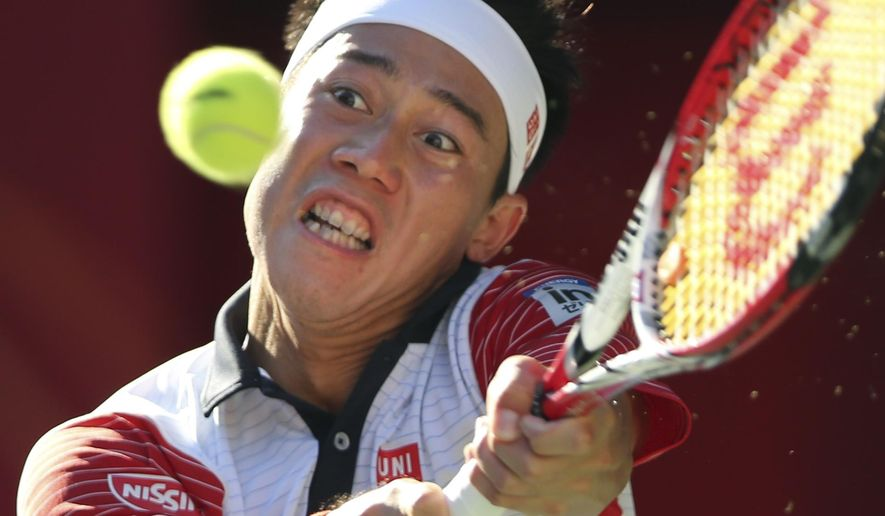 Kei Nishikori of Japan returns a shot against Jeremy Chardy of France during their quarter-final match of Japan Open Tennis Championships in Tokyo, Friday, Oct. 3, 2014. (AP Photo/Koji Sasahara)