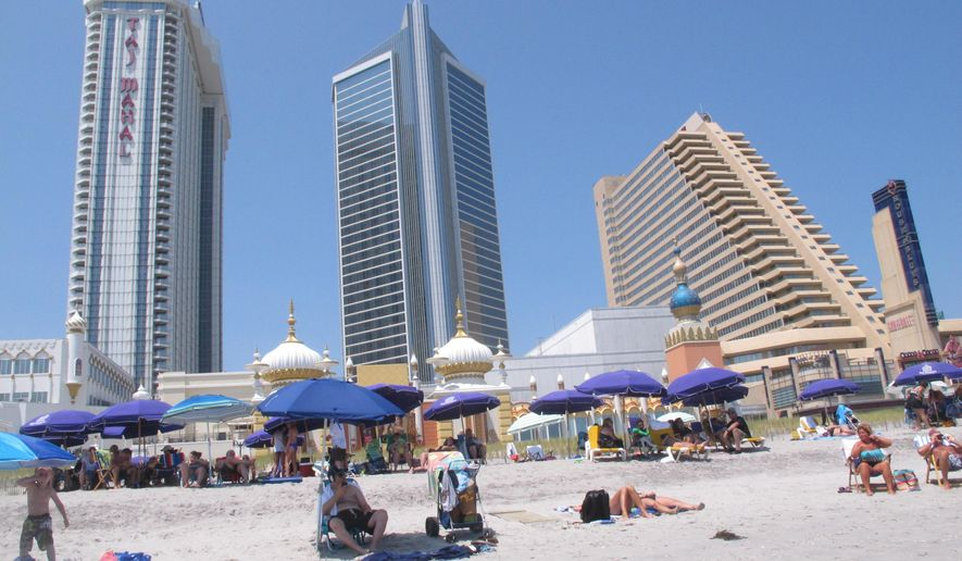FILE - This July 23, 2014 photo shows the Trump Taj Mahal Casino Resort, left, and the Showboat casino Hotel in Atlantic City N.J.  A Delaware bankruptcy judge on Friday, Oct. 3, 2014,  denied a request by Trump Entertainment Resorts to be relieved of its pension obligations under a collective bargaining agreement with union workers at the Taj Mahal casino in Atlantic City. (AP Photo/Wayne Parry)
