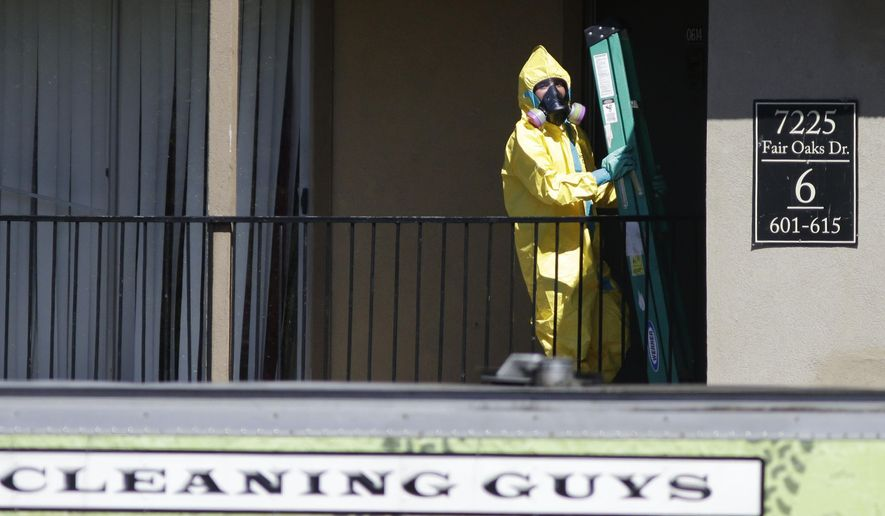 A hazardous material cleaner arrives at the apartment complex in Dallas, Friday, Oct. 3, 2014, where Thomas Eric Duncan, the Ebola patient who traveled from Liberia to Dallas stayed last week. The crew is expected to remove items including towels and bed sheets used by Duncan, who is being treated at an isolation unit at a Dallas hospital. The family living there has been confined under armed guard while being monitored by health officials. (AP Photo/LM Otero)