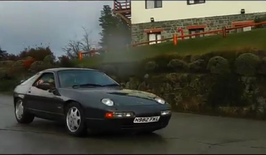 "In this screenshot from a Sept. 2014 video provided by Autoblog.com.ar, a Porsche with license plate H982 FKL, which was used by the BBC television program ""Top Gear,"" drives along a road near Bariloche, Argentina. The host of the program and other members of the crew fled Argentina on Friday, Oct. 3, 2014 after being pelted with rocks by people who believed one of their cars had a license plate alluding to the Falklands War. (AP Photo/Autoblog.com.ar)"