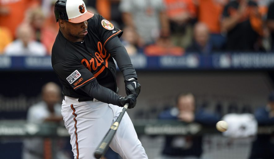Baltimore Orioles' Delmon Young hits a three-run double in the eighth inning of Game 2 in baseball's AL Division Series against the Detroit Tigers in Baltimore, Friday, Oct. 3, 2014. Baltimore won 7-6. (AP Photo/Nick Wass)