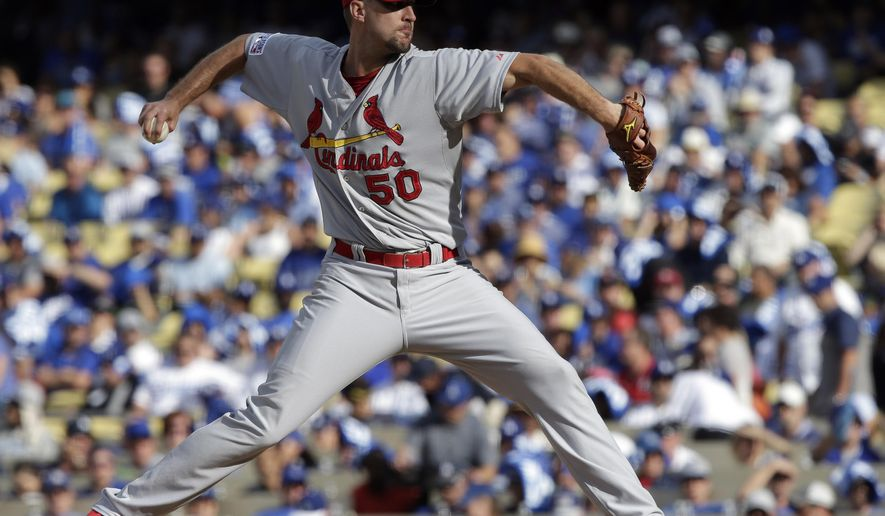 St. Louis Cardinals starting pitcher Adam Wainwright throws against the Los Angeles Dodgers during the second inning in Game 1 of baseball's NL Division Series in Los Angeles, Friday, Oct. 3, 2014. (AP Photo/Alex Gallardo)