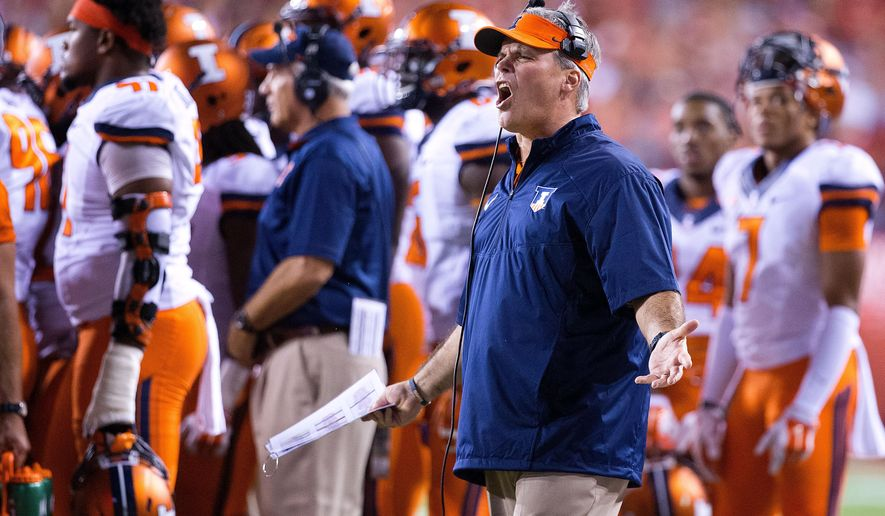 llinois coach Tim Beckman reacts to the flag called on Illinois in the first half of an NCAA college football game in Lincoln, Neb., Saturday, Sept. 27, 2014. Nebraska won 45-14.  (AP Photo/The Omaha World-Herald/Matt Miller)