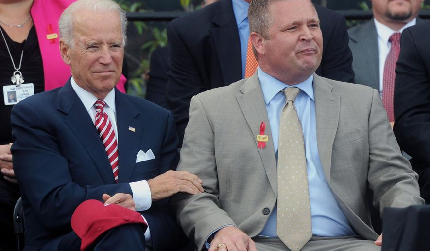 Vice President Joe Biden consoles Joplin Superintendent CJ Huff after Huff delivered an emotional speech during a dedication ceremony for a combined high school and vocational school that replaces one destroyed by a deadly tornado more than three years ago, Friday, Oct. 3, 2014, in Joplin, Mo. (AP Photo/The Joplin Globe, Laurie Sisk)