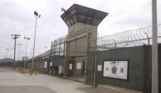 In this June 7, 2014, file photo, the entrance to Camp 5 and Camp 6 at the U.S. military's Guantanamo Bay detention center at Guantanamo Bay Naval Base, Cuba. U.S. District Court Judge Gladys Kessler on Friday ordered the public release of 28 videotapes of a hunger-striking Guantanamo Bay prisoner strike being forcibly removed from his cell and force-fed. (AP Photo/Ben Fox, File )