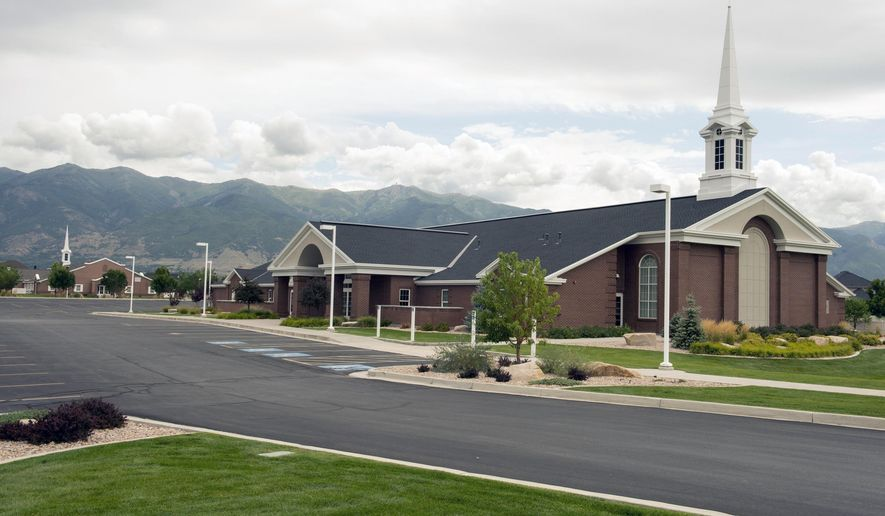 This Thursday, Aug. 21, 2014 photo shows two LDS chapels built adjacent to each other on Angel Street, in Kaysville, Utah. An old joke says it's impossible to throw a pebble in any direction in Utah without hitting an LDS chapel. Or maybe two. A data analysis by The Salt Lake Tribune shows that wisecrack may not be far from the truth. (AP Photo/The Salt Lake Tribune, Rick Egan)  DESERET NEWS OUT; LOCAL TELEVISION OUT; MAGS OUT