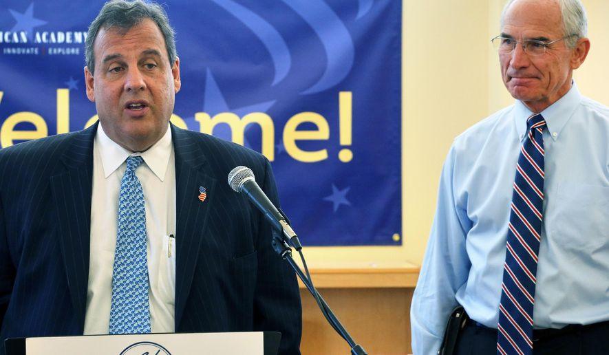 GOP gubernatorial candidate Bob Beauprez, right, watches as New Jersey Gov. Chris Christie, left, takes questions from members of the media, during a visit to American Academy, a charter elementary school in Castle Pines, Colo., Friday Oct. 3, 2014. Christie was in Colorado to campaign for Beauprez. (AP Photo/Brennan Linsley)