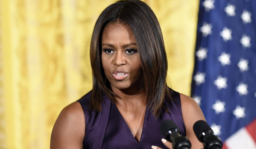 FILE - In this Tuesday, Sept. 30, 2014 file photo, first lady Michelle Obama speaks at a luncheon in the East Room of the White House in Washington, to honor of the winners of the 2014 National Design Awards, which are organized by the Smithsonian's Cooper-Hewitt, National Design Museum. The first lady is making a political visit to New England on behalf of Democrats running for governor in Massachusetts and Maine. Obama's first stop on Friday, Oct. 3, 2014, will be the Strand Theatre in Boston's Dorchester neighborhood, where she is scheduled to highlight a rally for state Attorney General Martha Coakley. (AP Photo/Susan Walsh, file)