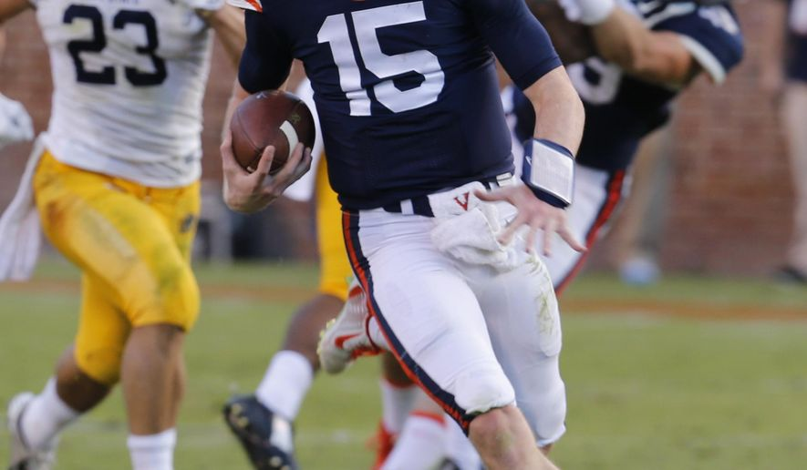 Virginia quarterback Matt Johns (15) gains yardage during the second half of an NCAA college football game in Charlottesville, Va., Saturday, Sept. 27, 2014.  Virginia won the game 45-13.  (AP Photo/Steve Helber)