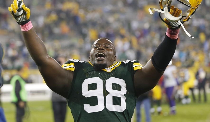 Green Bay Packers' Letroy Guion celebrates after an NFL football game against the Minnesota Vikings Thursday, Oct. 2, 2014, in Green Bay, Wis. The Packers won 42-10. (AP Photo/Mike Roemer)