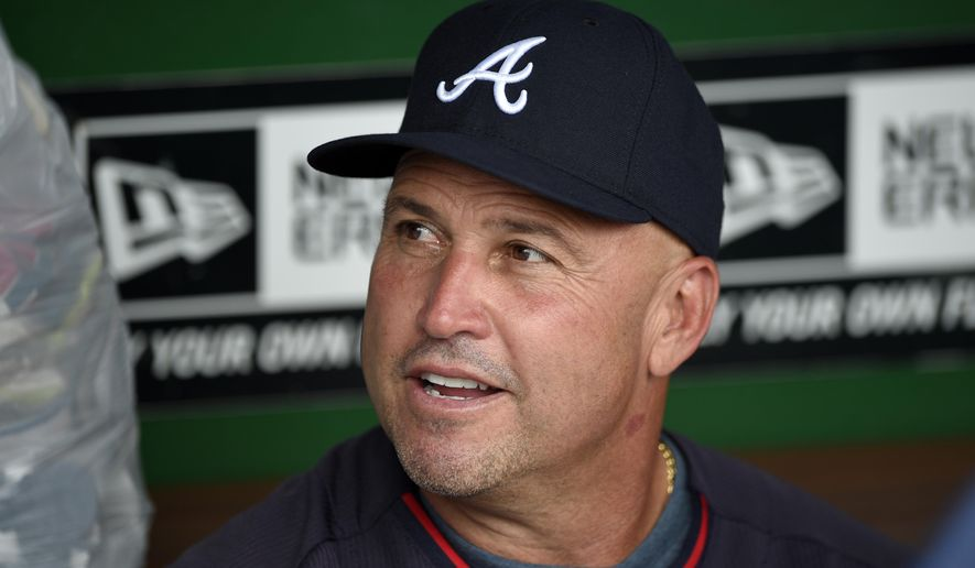 In this Sept. 10, 2014, file photo, Atlanta Braves manager Fredi Gonzalez talks to the media before a baseball game against the Washington Nationals in Washington. Gonzalez will return as the Braves manager next season. Interim general manager John Hart made the announcement Friday, Oct. 3, 2014. (AP Photo/Nick Wass, File)