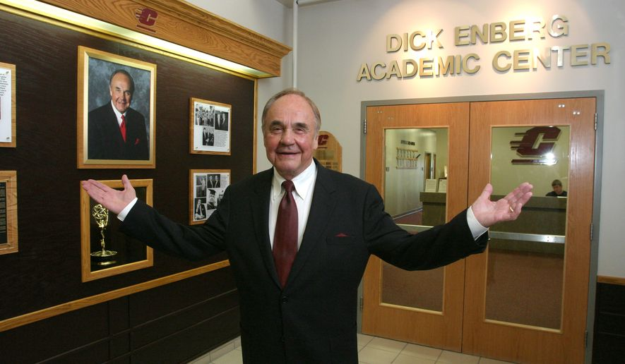 This photo provided by The Central Michigan University shows 1957 CMU graduate Dick Enberg posing at the student-athlete academic center named in his honor in CMU's Indoor Athletic Complex Friday, Oct. 12, 2007, in Mount Pleasant, Mich. (AP Photo/CMU, Robert Barclay)