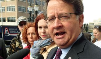 Michigan Rep. Gary Peters talks to reporters before turning in signatures to run for a Michigan U.S. Senate seat on April 21, 2014, in Lansing. (Associated Press) **FILE**