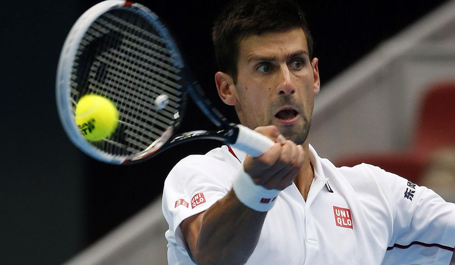 Novak Djokovic of Serbia returns a shot against Grigor Dimitrov of Bulgaria during their quarterfinal match of China Open tennis tournament in Beijing, China, Friday, Oct. 3, 2014. (AP Photo/Vincent Thian)