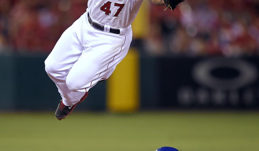 Kansas City Royals' Terrance Gore steals second under the tag of Los Angeles Angels second baseman Howie Kendrick during the 10th inning of baseball's Game 1 of the AL Division Series in Anaheim, Calif., Thursday, Oct. 2, 2014. (AP Photo/Mark J. Terrill)