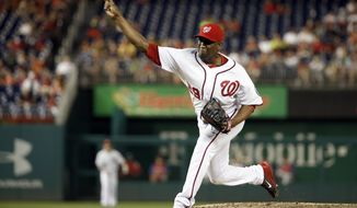In this photo taken Sept. 5, 2014, Washington Nationals relief pitcher Rafael Soriano throws during the ninth inning of a baseball game against the Philadelphia Phillies at Nationals Park in Washington. Left-hander Ross Detwiler has been left off the Washington Nationals' roster for their NL Division Series against the San Francisco Giants while former closer Rafael Soriano made the 25-man cut.  (AP Photo/Alex Brandon)