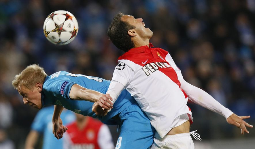Monaco's Ricardo Carvalho, right, and Zenit's Igor Smolnikov struggle for the ball during the Champions League Group C soccer match between Zenit and Monaco at Petrovsky stadium in St.Petersburg, Russia, Wednesday Oct. 1, 2014. (AP Photo/Dmitry Lovetsky)