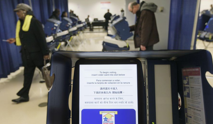 In this Feb. 27, 2012, file photo, voters cast their ballots during early voting at the Board of Elections building, in downtown Chicago. (AP Photo/M. Spencer Green) ** FILE **