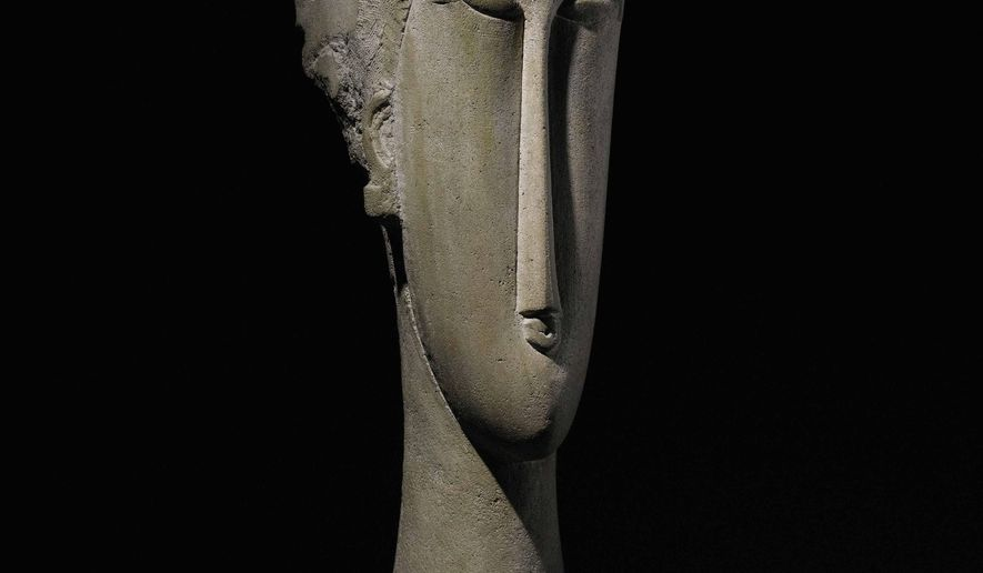 """This undated photo provided by Sotheby's shows Amedeo Modigliani's """"Tete"""" sculpted from a block of limestone scavenged from a Paris construction site. One of two rare sculptures  inspired by goddesses, it is among the prized pieces to be sold at Sotheby's impressionist and modern art auction in New York. Another one is Alberto Giacometti's """"Chariot"""" is a bronze sculpture of an elongated figure atop a wheeled chariot. (AP Photo/Sotheby's)"""