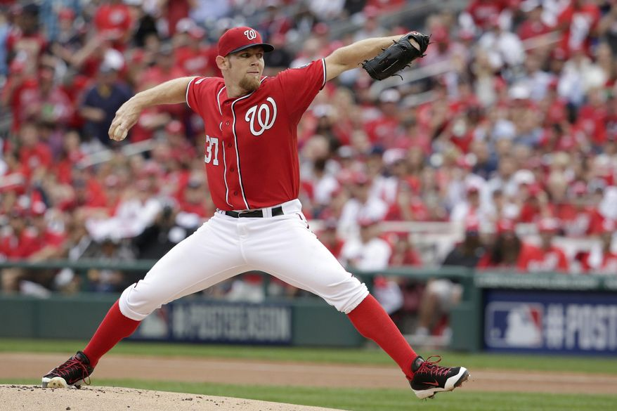 Washington Nationals starting pitcher Stephen Strasburg (37) throws in the first inning of Game 1 in a NL Division Series baseball game against the San Francisco Giants, Friday, Oct. 3, 2014 at Nationals Park in Washington. (AP Photo/Pablo Martinez Monsivais)  **FILE**