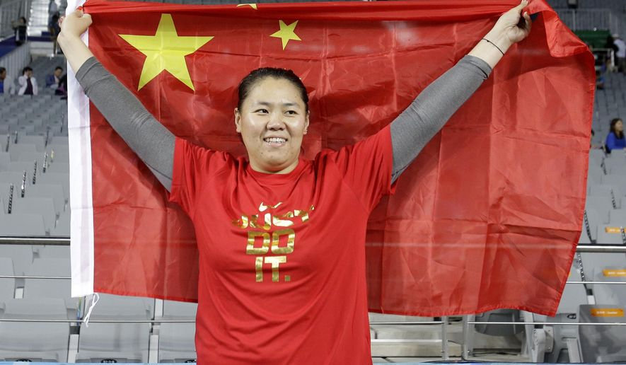 China's Zhang Wenxiu celebrates after winning the women's hammer throw competition at the 17th Asian Games in Incheon, South Korea, Sunday, Sept. 28, 2014. (AP Photo/Lee Jin-man)