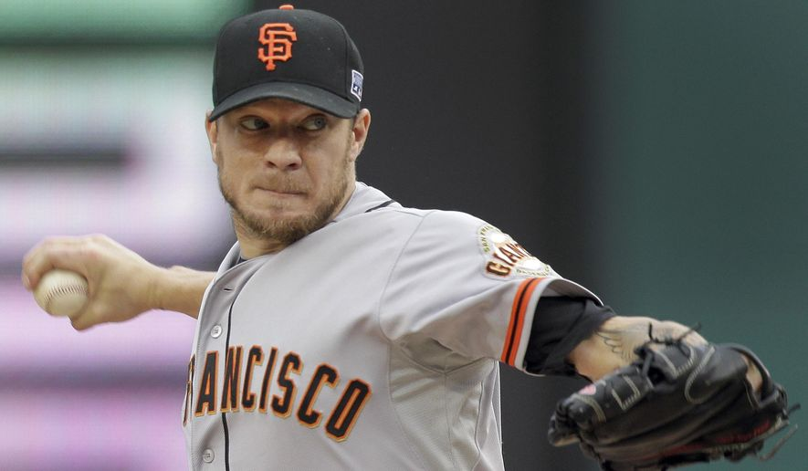 San Francisco Giants starting pitcher Jake Peavy (22) throws in the second inning of  Game 1 of baseball's NL Division Series against the Washington Nationals, Friday, Oct. 3, 2014, in Washington. (AP Photo/Mark Tenally)