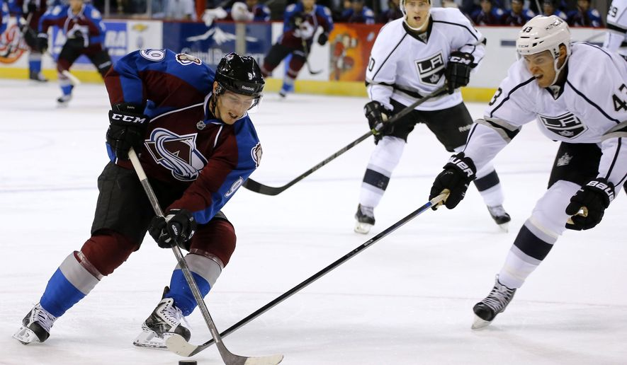 Colorado Avalanche center Matt Duchene (9) moves the puck past Los Angeles Kings defenseman Brayden McNabb (43) during the first period of a preseason NHL hockey game Thursday, Oct. 2, 2014, in Colorado Springs, Colo. (AP Photo/Jack Dempsey)