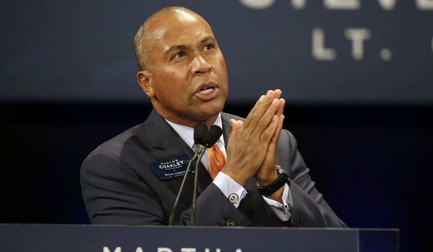 Massachusetts Gov. Deval Patrick gestures as he campaigns in support of Massachusetts Democratic gubernatorial candidate Martha Coakley during a Coakley for Governor campaign event, Friday, Oct. 3, 2014, at the Strand Theatre in Boston. First lady Michelle Obama also spoke at the event in support of Cokley. (AP Photo/Stephan Savoia)
