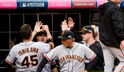 San Francisco Giants first baseman Travis Ishikawa (45) scores the first run in the game in the third inning as the Washington Nationals play the San Francisco Giants at Nationals Park for Game 1 of the National League Division Series, Washington, D.C., Friday, October 3, 2014. (Andrew Harnik/The Washington Times)