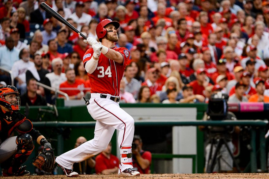 Washington Nationals left fielder Bryce Harper (34) hits a home run single to put the Nationals on the scoreboard in the seventh inning as the Washington Nationals play the San Francisco Giants at Nationals Park for Game 1 of the National League Division Series, Washington, D.C., Friday, October 3, 2014. (Andrew Harnik/The Washington Times)