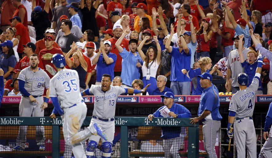 Fans cheer as Kansas City Royals players celebrate after Eric Hosmer (35) hit a two-run home run against the Los Angeles Angels in the 11th inning of Game 2 of baseball's AL Division Series in Anaheim, Calif., Friday, Oct. 3, 2014. The Royals won 4-1. (AP Photo/Lenny Ignelzi)