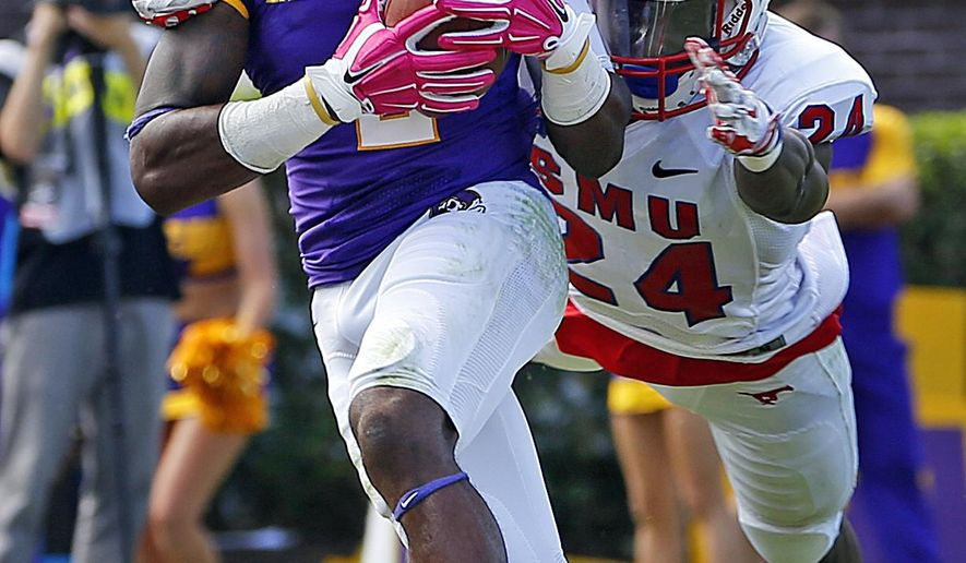 East Carolina's Justin Hardy (2) breaks the tackle of Southern Methodist's JR Richardson (24) to score a touchdown during the first half of an NCAA college football game in Greenville, N.C., Saturday, Oct. 4, 2014. (AP Photo/Karl B DeBlaker)