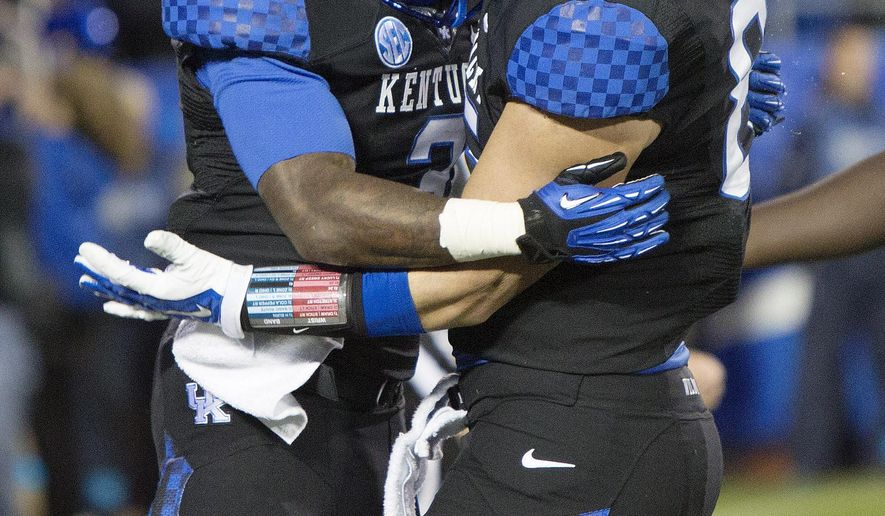 Kentucky running back Jojo Kemp, left, and tight end Steven Borden celebrate Kemp's touchdown during the first half of an NCAA college football game against South Carolina at Commonwealth Stadium in Lexington, Ky., Saturday, Oct. 4, 2014. (AP Photo/David Stephenson)