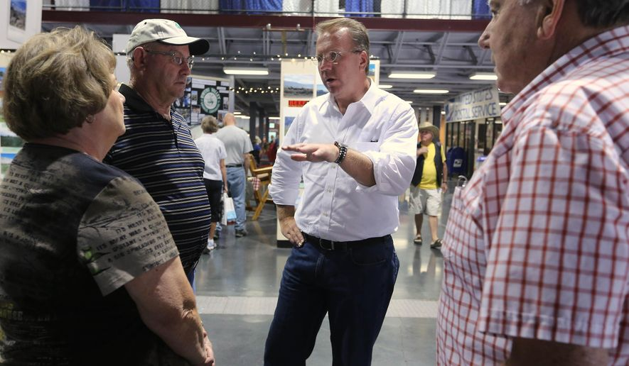 In this photo taken Friday, July 18, 2014, Ron Nehring, the Republican candidate for Lt. Governor talks with visitors to the California State Fair in Sacramento, Calif.  Nehring is trying to unseat in incumbent Lt. Gov. Gavin Newsom, a Democrat, in the November election.(AP Photo/Rich Pedroncelli)