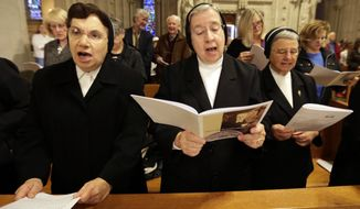 Nuns sing during a beatification ceremony for Sister Miriam Teresa Demjanovich at Cathedral Basilica of the Sacred Heart, Saturday, Oct. 4, 2014, in Newark, N.J. Demjanovich, who died in 1927 at age 26, is credited with curing Michael Mencer's eye disease as a boy when he was given a lock of the nun's hair and prayed to her. The ceremony moves Demjanovich a step closer to sainthood with her beatification as it is the third in a four-step process. (AP Photo/Julio Cortez) **FILE**